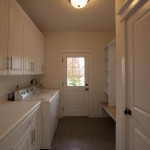 Combined laundry & mud room maximizes space.