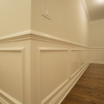 beautiful wainscotting and detailed trimwork are extensive throughout the house