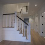 staircase with grayed white oak floors